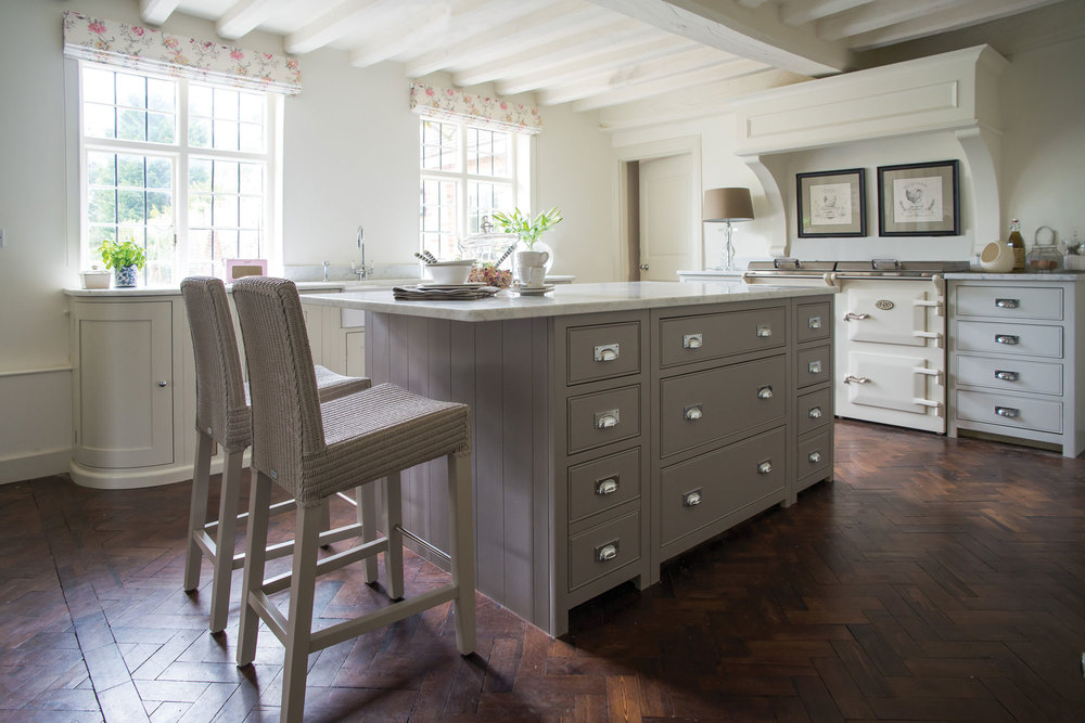 Neptune Chichester island painted in Grey Oak with quartz worktop