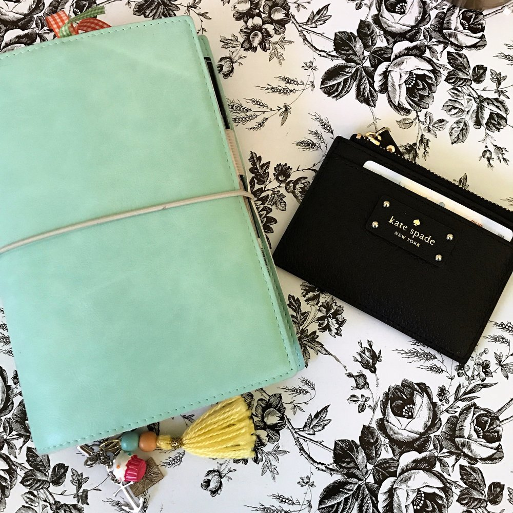 "My ""on-the-go"" personal planner and my Kate Spade card holder/coin purse."