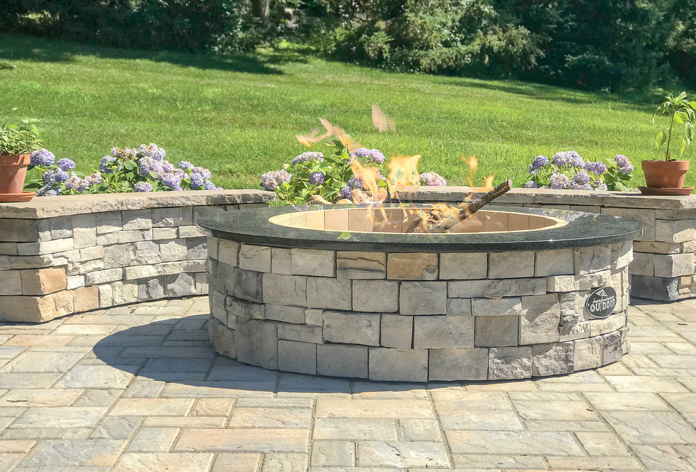 Fire Pit - Wood burning firepits make a great centerpiece for conversations around a fire.Our fire pits are equipped with granite tops, stone veneer sides and are lined with high temp fire bricks for years of trouble free use.