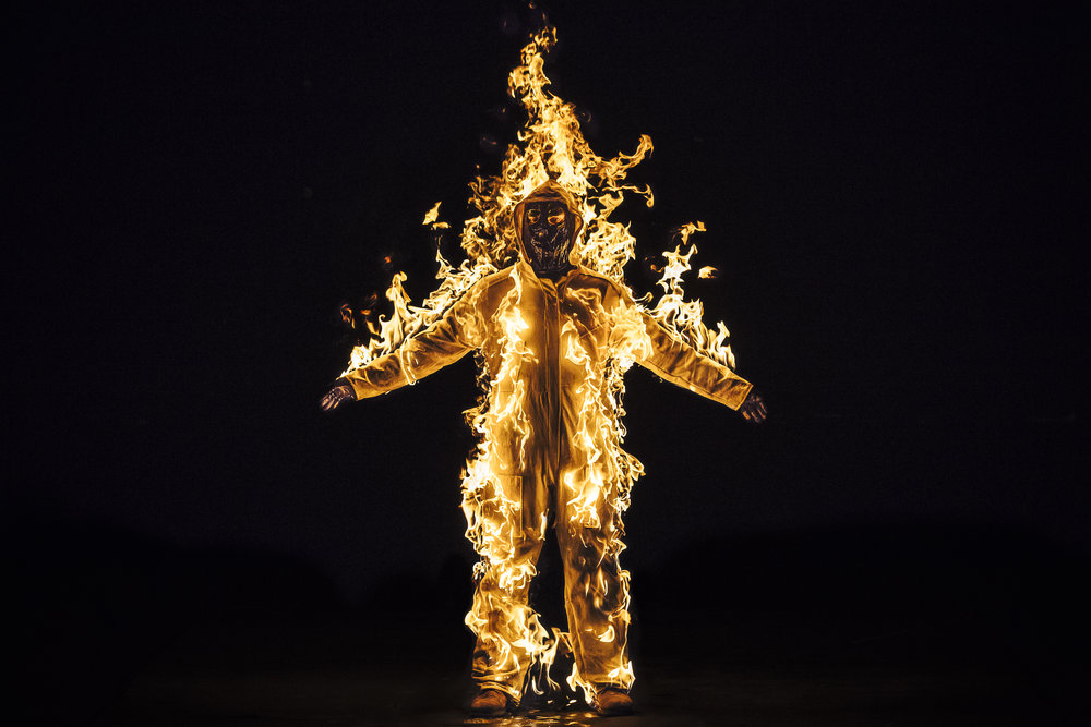 Cassils is lit on fire during their performance Inextinguishable Fire, performed on Nov 8, 2015 at the National Theatre in London as part of SPILL Festival of Performance. Photo credit: Cassils with Guido Mencari © Cassils 2015 Image courtesy of the artist and Ronald Feldman Fine Arts