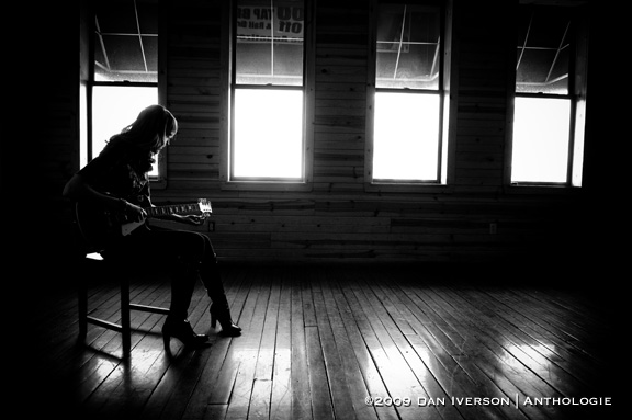Meredith Fierke tunes her Les Paul during a photo session Feb. 16 at the Rueb 'N' Stein in Northfield, Minn.