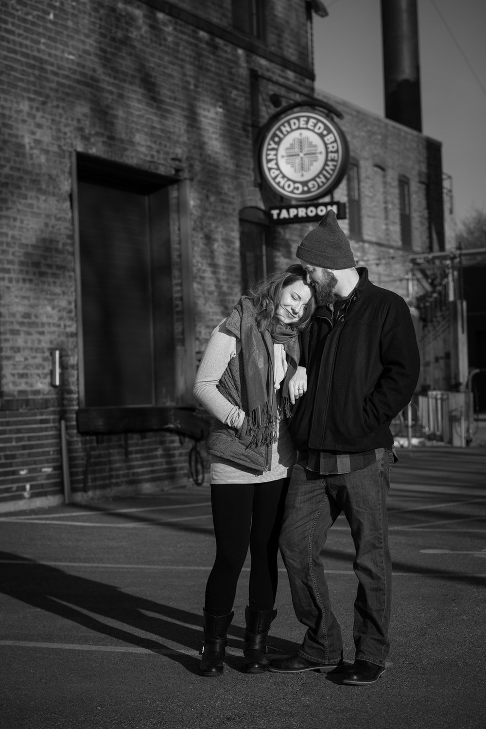 Nicole and Patrick snuggle outside the Indeed Brewing Company Taproom in Minneapolis