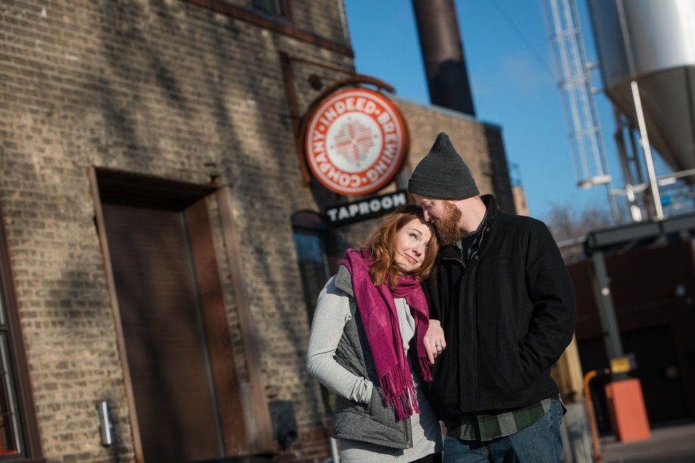 cold temps couldn't keep nicole and patrick from warming each other up outside indeed brewing company in Minneapolis