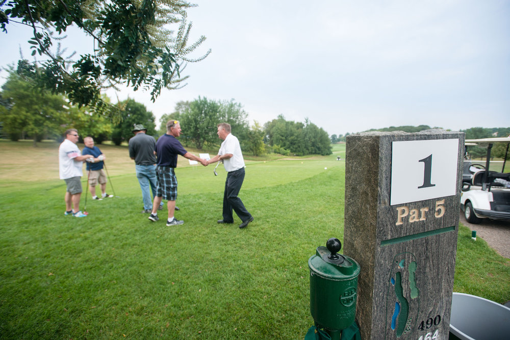 Golfers greet each other as the Minnesota Eagle Heroes Golf Tournament gets underway at Crystal Lake Golf Course in Lakeville, MN. Photo by Minnesota Event and Fundraising photographer Anthologie.