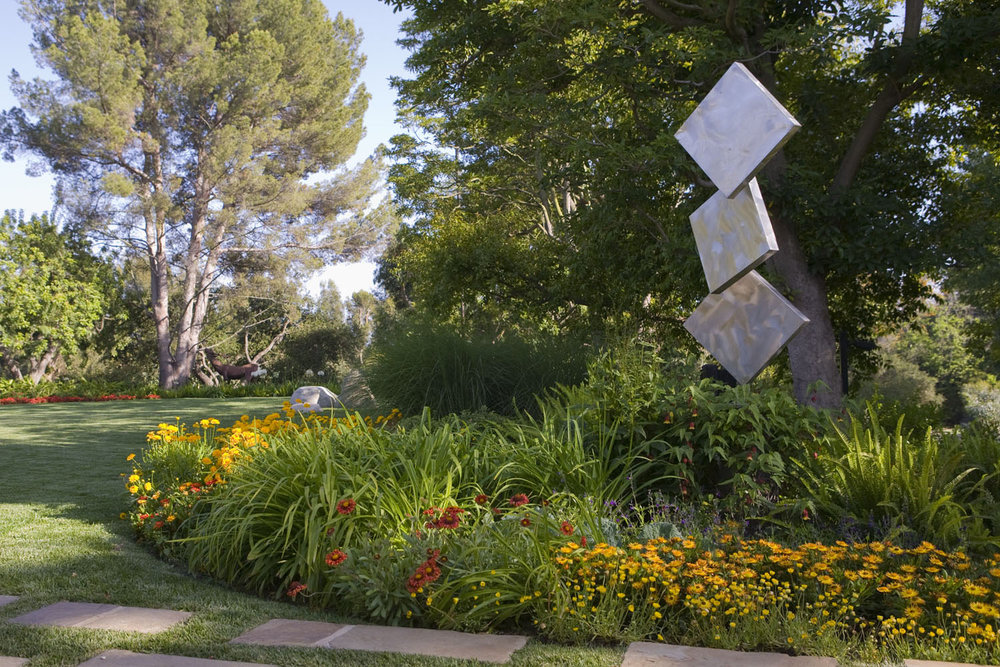 Before: Turf and perennials surround a kinetic sculpture by George Rickey.