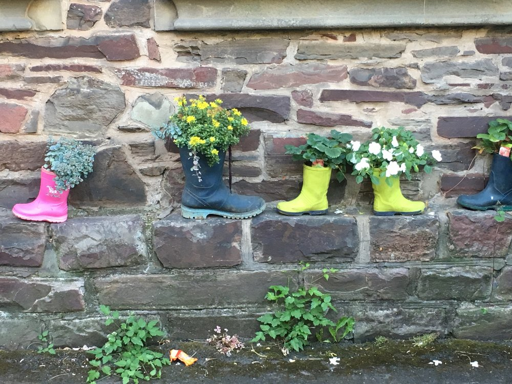 Children's wellies form sweet little planters in the sleepy village of Moselkern, Germany.