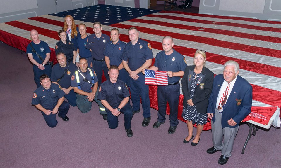 Franklin Elks Officers with the Franklin Fire Department after we donated the pictured American Flag in 2018 with a Gratitude Grant.