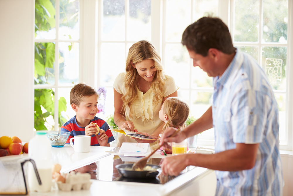 stock-photo-smiling-family-cooking-together-in-the-kitchen-55864873.jpg
