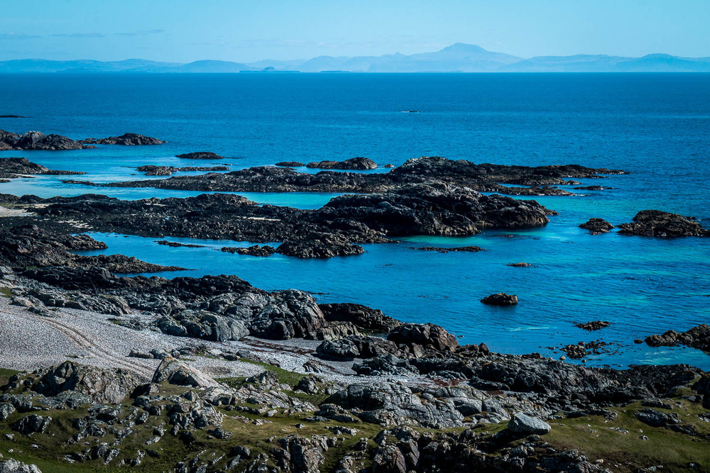 Looking east from Cleit Mhor, the Treshnish Isles and Ben More on Mull in the horizon.