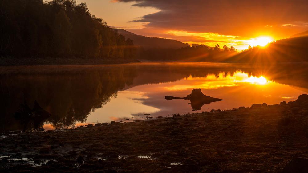 Loch Beinn A' Mheadhoin at sunrise.