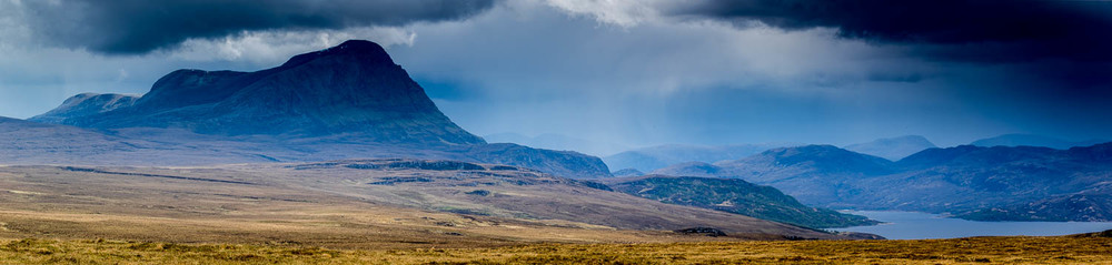 Ben Hope and Loch Hope under the approaching rain.