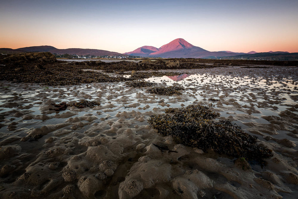 First light on the tops of Beinn Na Caillich from Breakish beach.