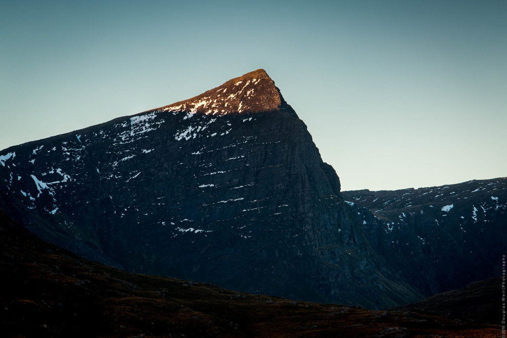The unmistakable peak of Sgurr Fhidhleir lit by the morning sun.