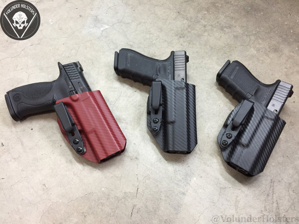 Orthrus 3 M&P 425 Glock 17 and Glock 19 in black and blood red carbon fiber v1 cement.jpg