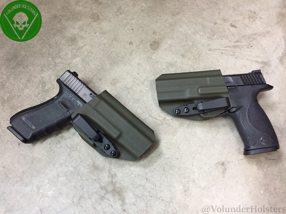 ODGreen Orthrus M&P and Glock 17 cement background with green logo for st patty day v1.jpg