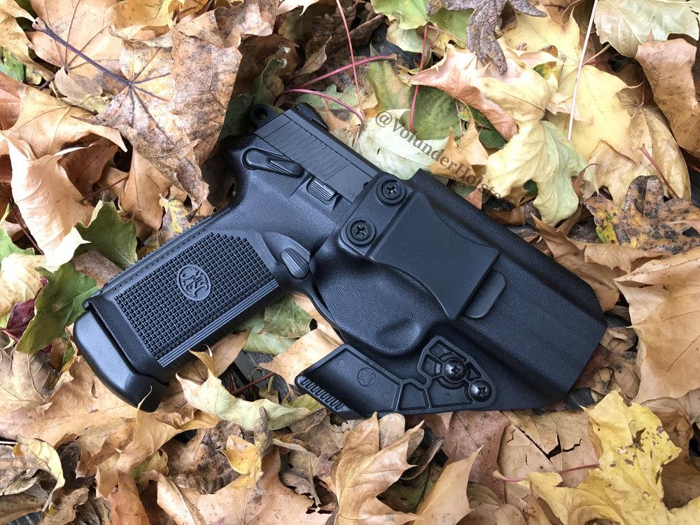 Garm with Claw FNX 45 on leafs v1.jpg
