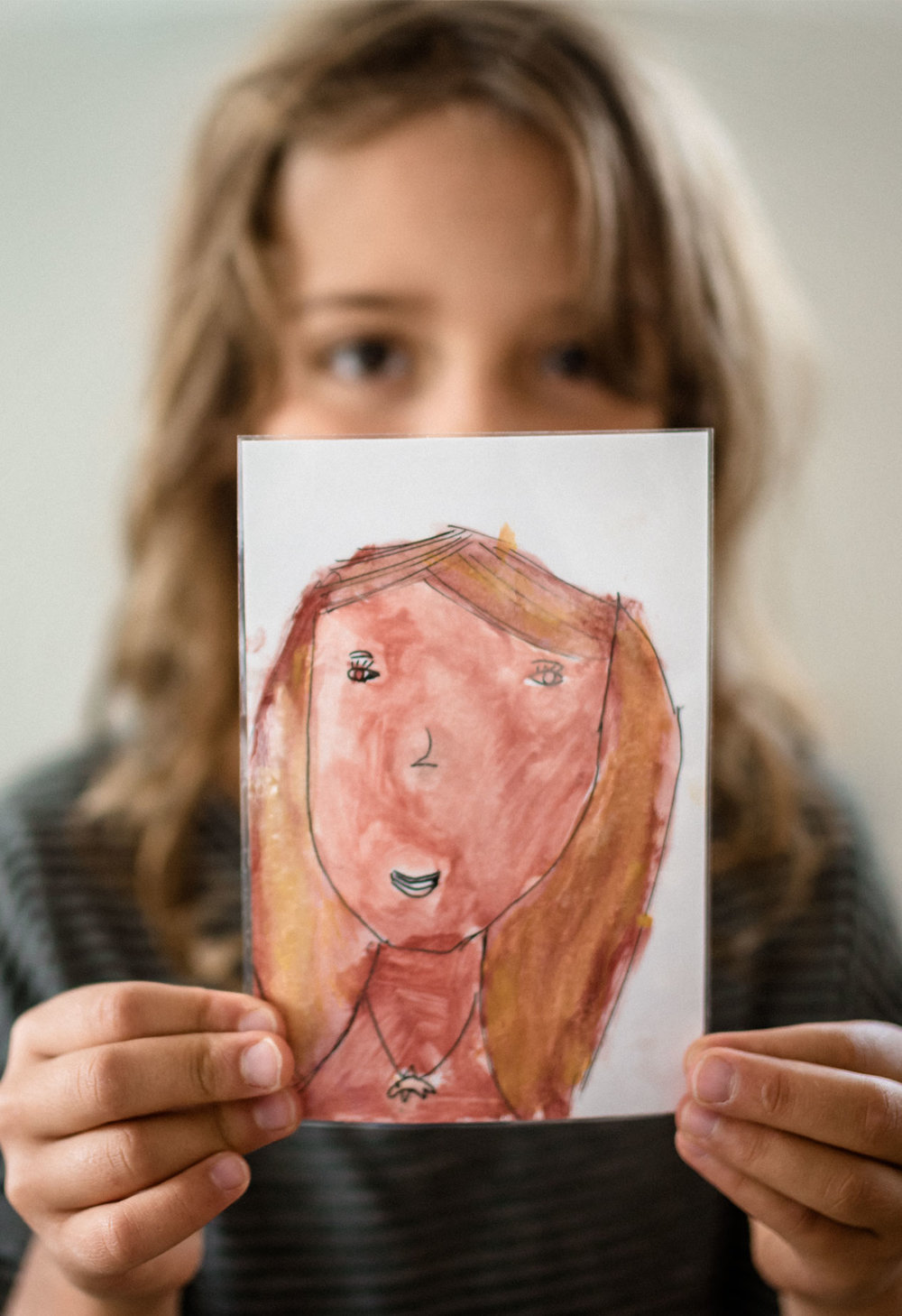 a portrait of a child with a self-portrait she draw by Anita Perminova