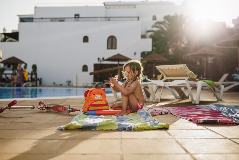 natural light documentary photography a girl by a swimming pool with Olaf by Anita Perminova