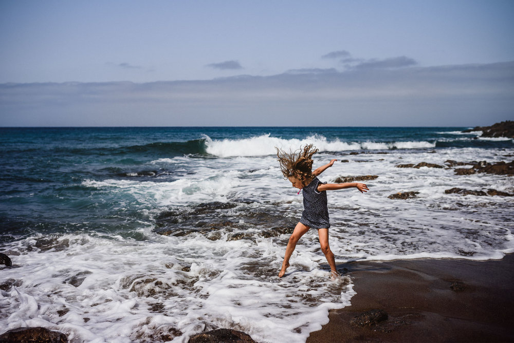 girl jumping in the waves lifestyle photography by Anita Perminova