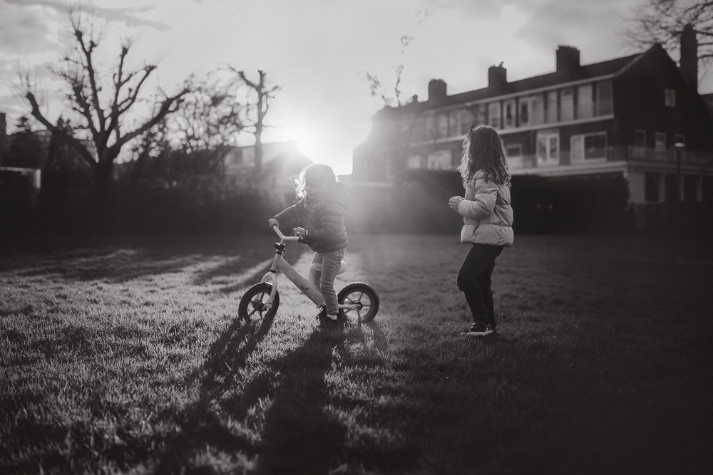 natural light sunset sisters on a bike