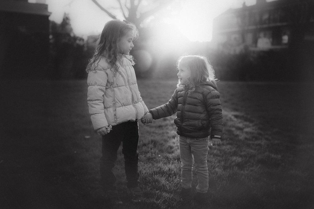 natural light sunset two girls holiding hands