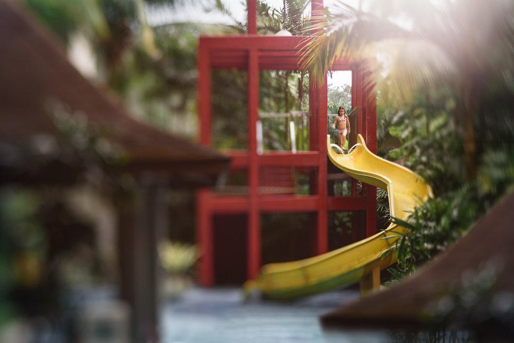 a girl on a yellow slide in a swimming pool Mont Kiara Kuala Lumpur Malaysia