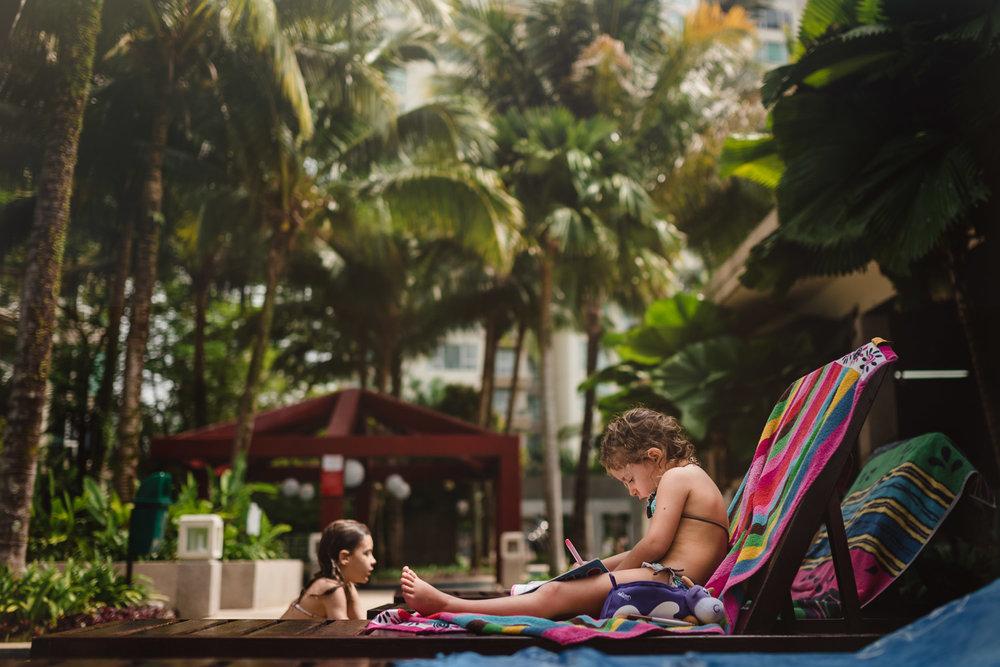 girls by a swimming pool Mont Kiara Kuala Lumpur Malaysia