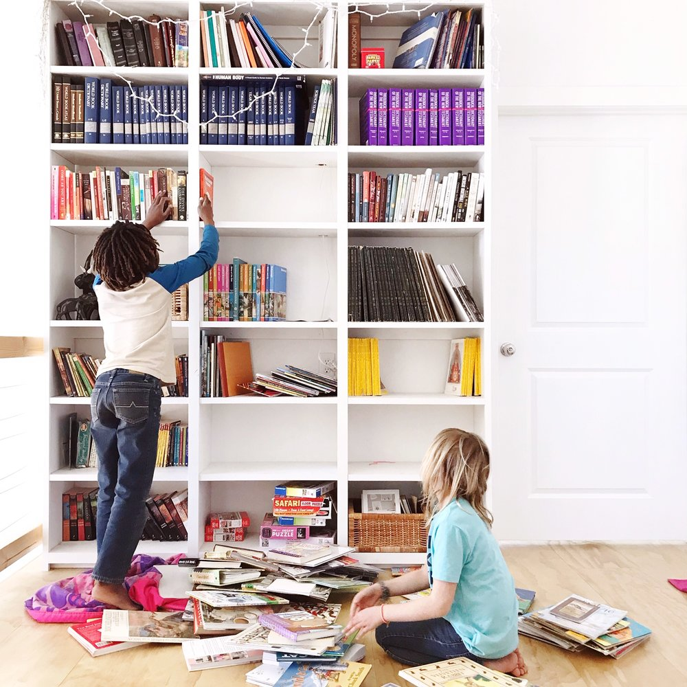 These fools made the mistake of saying they were bored while the electricity was out. By all means children, clean and organize the bookshelves.