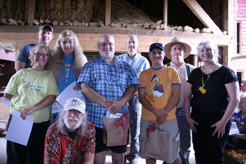 Pictured 2017 Contestants, from left to right, Jared Flesher, Judy England-McCarthy, Robin Reichert, Mike Agranoff, Joey Novick, Ken Karnas, Elizabeth, and Farmer Rob, our winner, with MC Denise McCormack