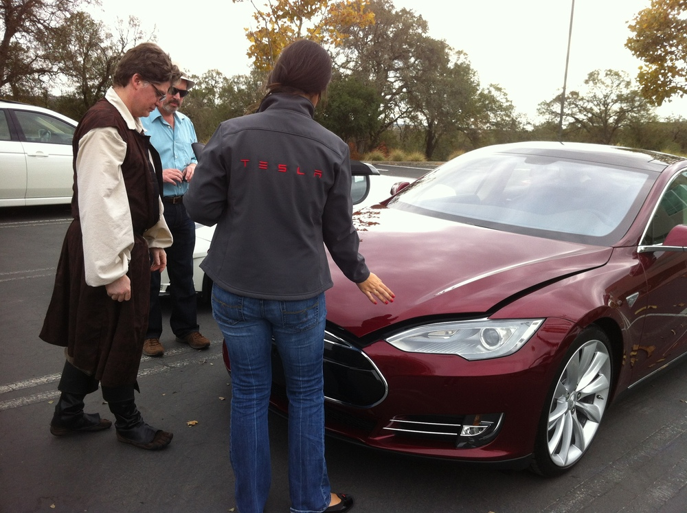 Jason S takes delivery of his Model S on Halloween (hence the costume)