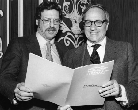 Michael Meltsner (L) and Law School Dean O'Toole (R) look at a Law School brochure.  Photo courtesy of Northeastern Libraries.