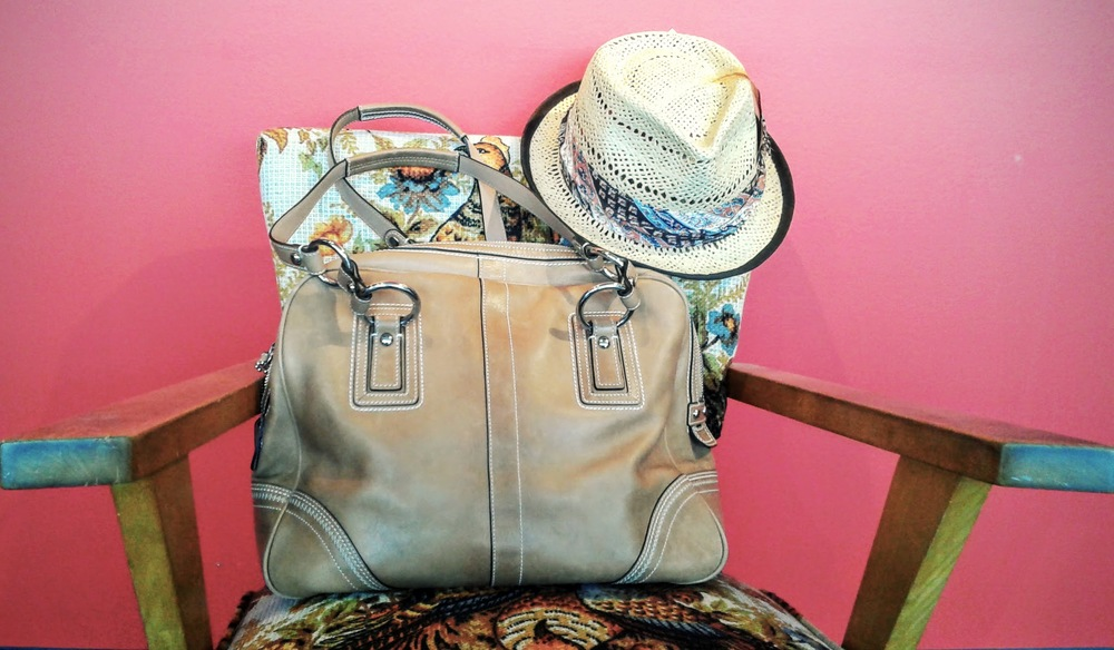 "Coach bag; $225. deLux ""Madeline"" hat; $29"