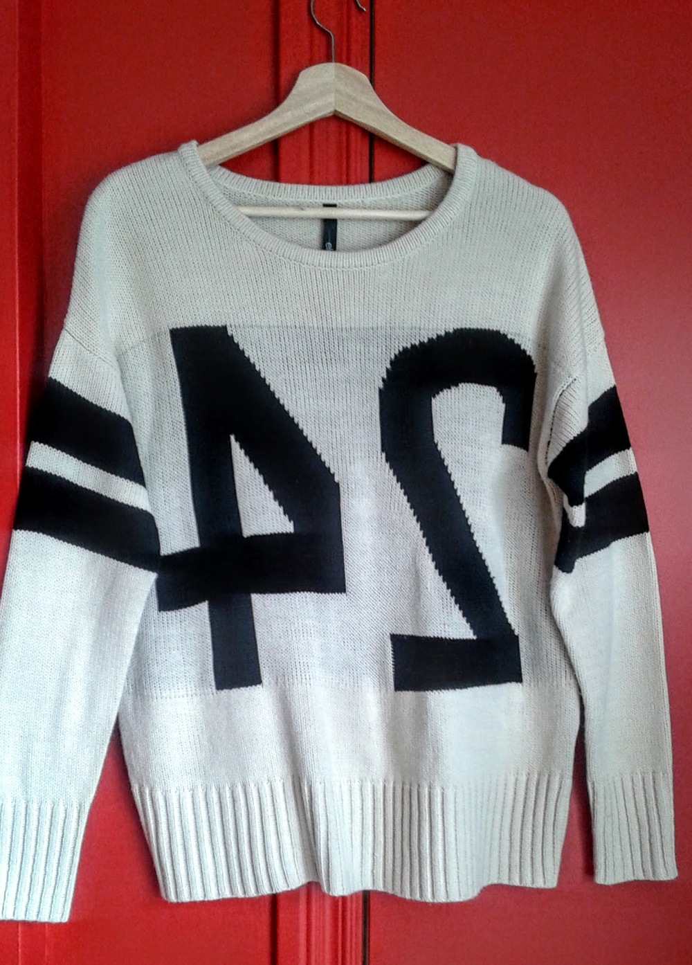 Backwards sweater; size M, $26