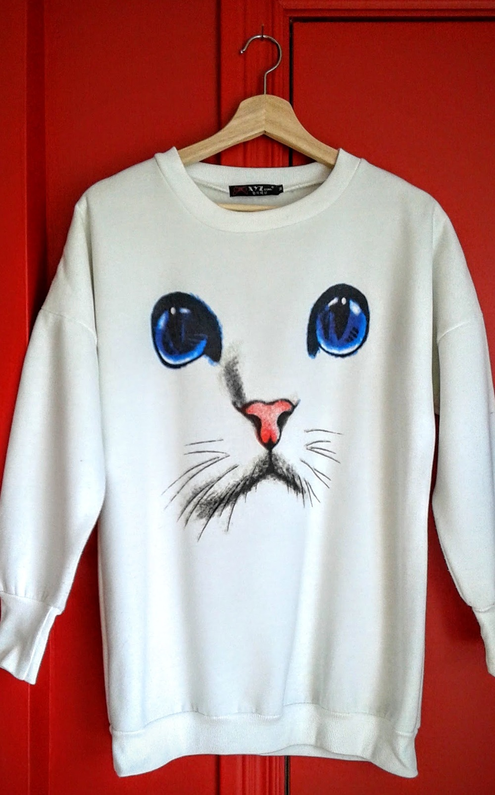 Cat sweatshirt; Size M, $26