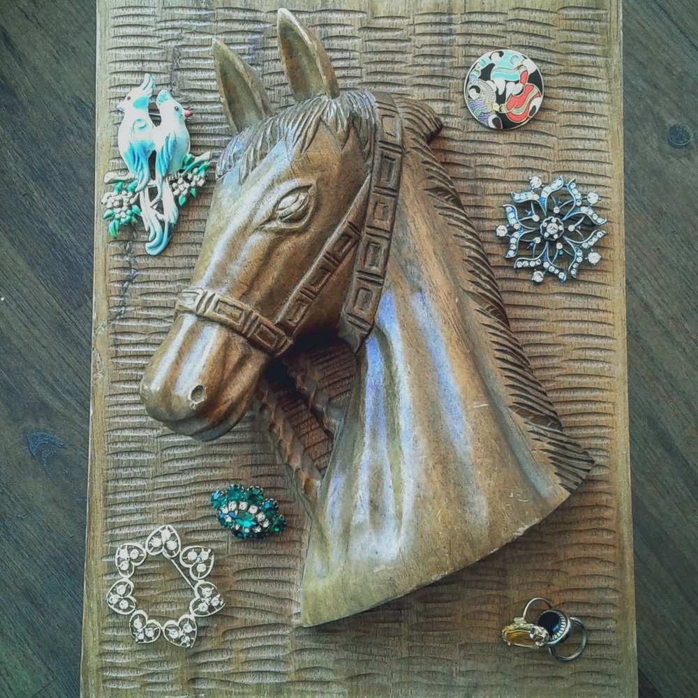 Bird pin, $22; Round pin, $20; Snowflake pin, $22; Yellow ring, $14; Black ring, $12; Golden snowflake pin, $22; Emerald cluster broach, $26