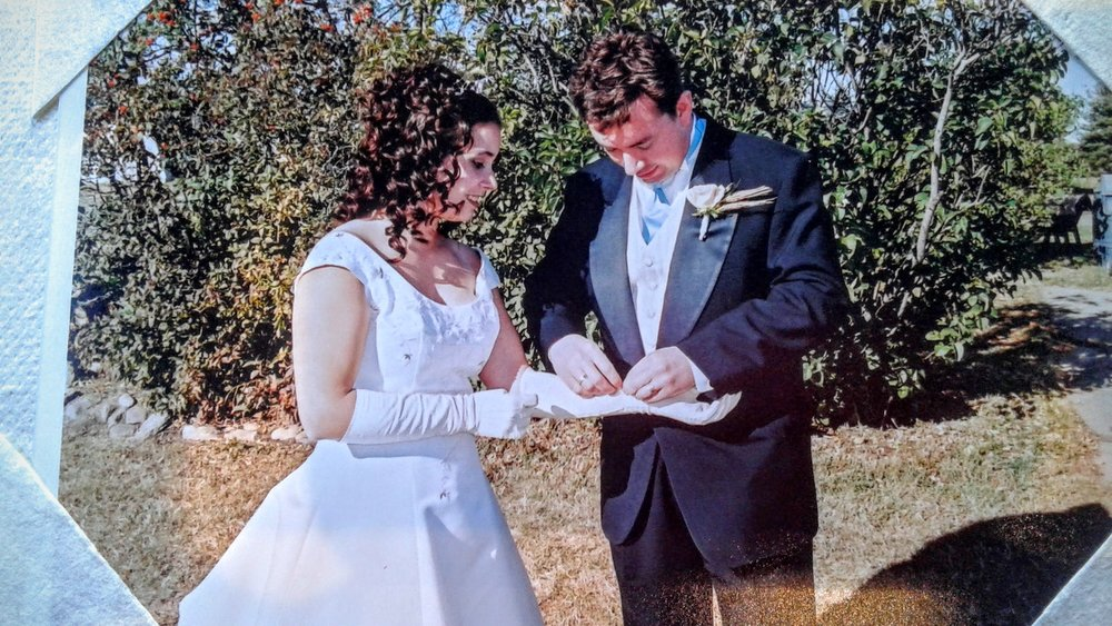Rod doing up the wee buttons at the wrist