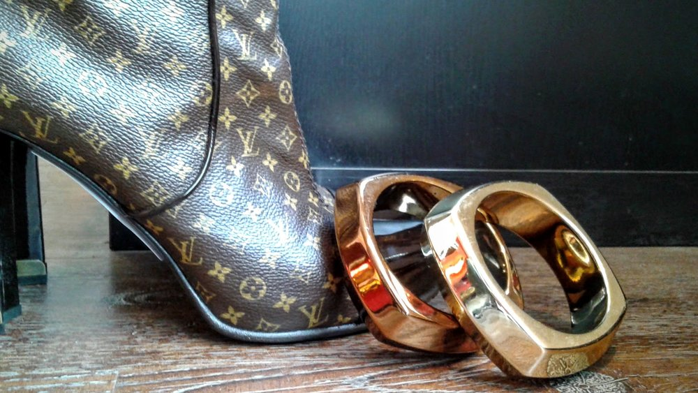 Bracelets, $12 each;  Louis Vuitton  boots, S7.5 $750
