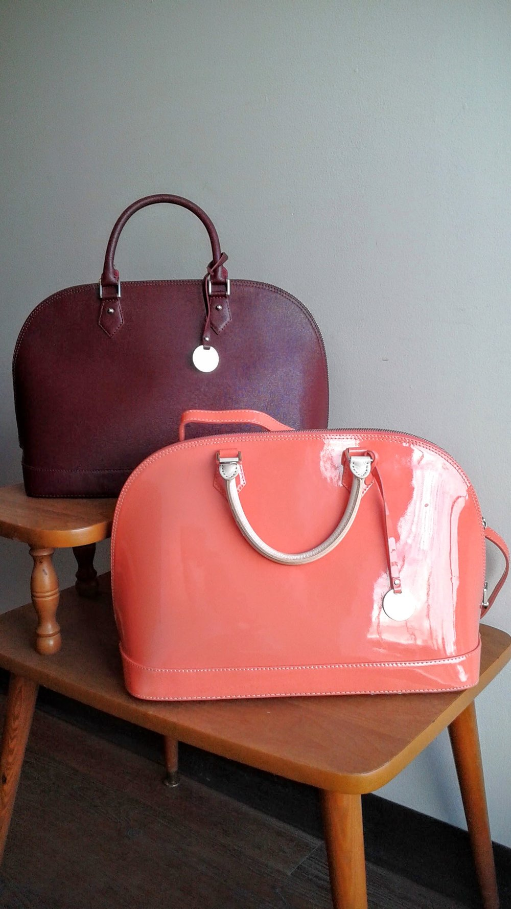 Pulicati bag; Maroon, $175; Coral, $125