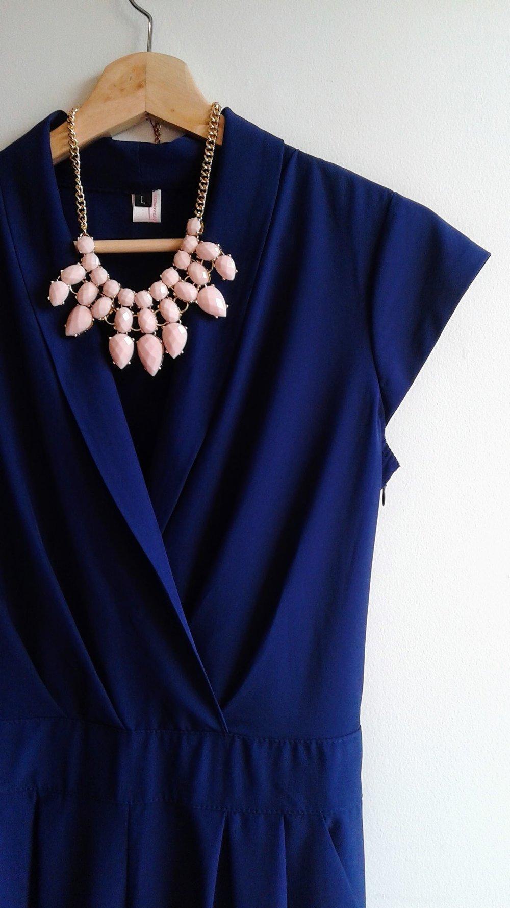 Jump suit; Size L, $36. Necklace, $28