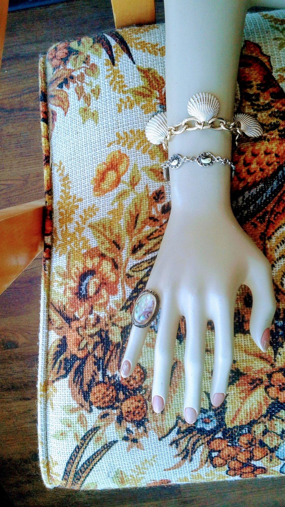 Shell bracelette, $14; Yin-yang bracelette, $12; Ring, $20