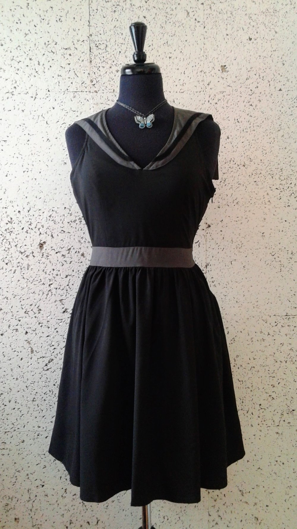 Sourpuss  dress (NWT); Size S, $38. Necklace, $30