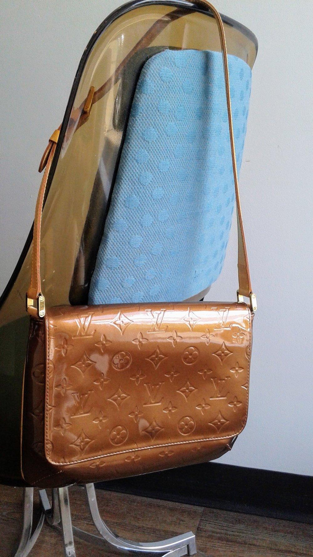 Louis Vuitton purse, $275