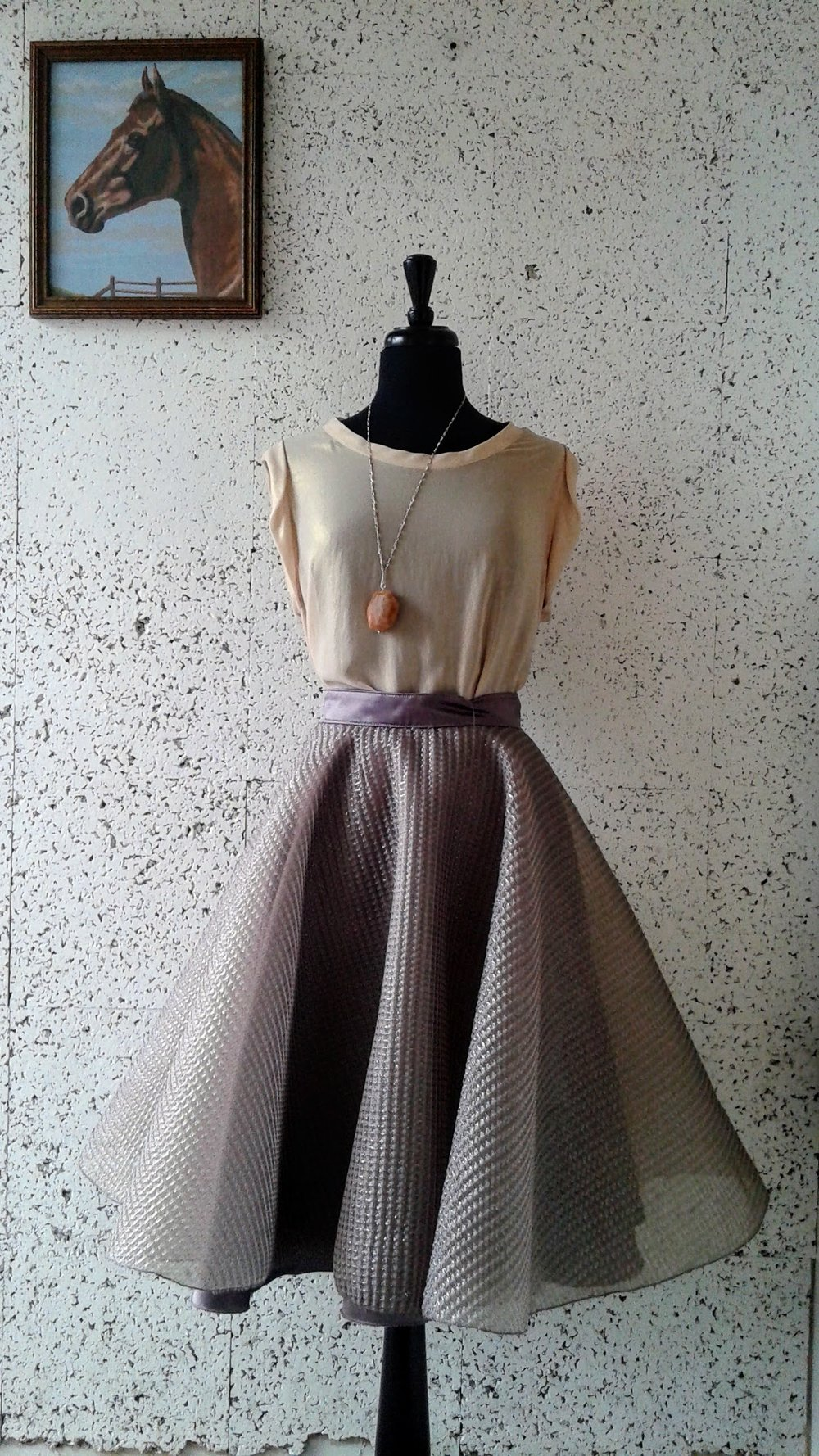 Trisha Pasnak skirt; Size 0, $75. Tara Jarmon top; Size M, $30. Necklace $24