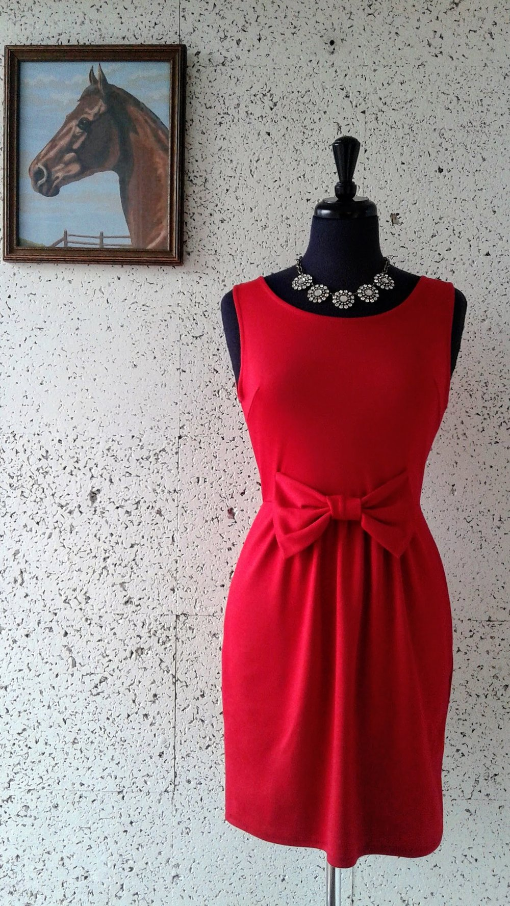Everly  dress; Size M, $26. Necklace, $38