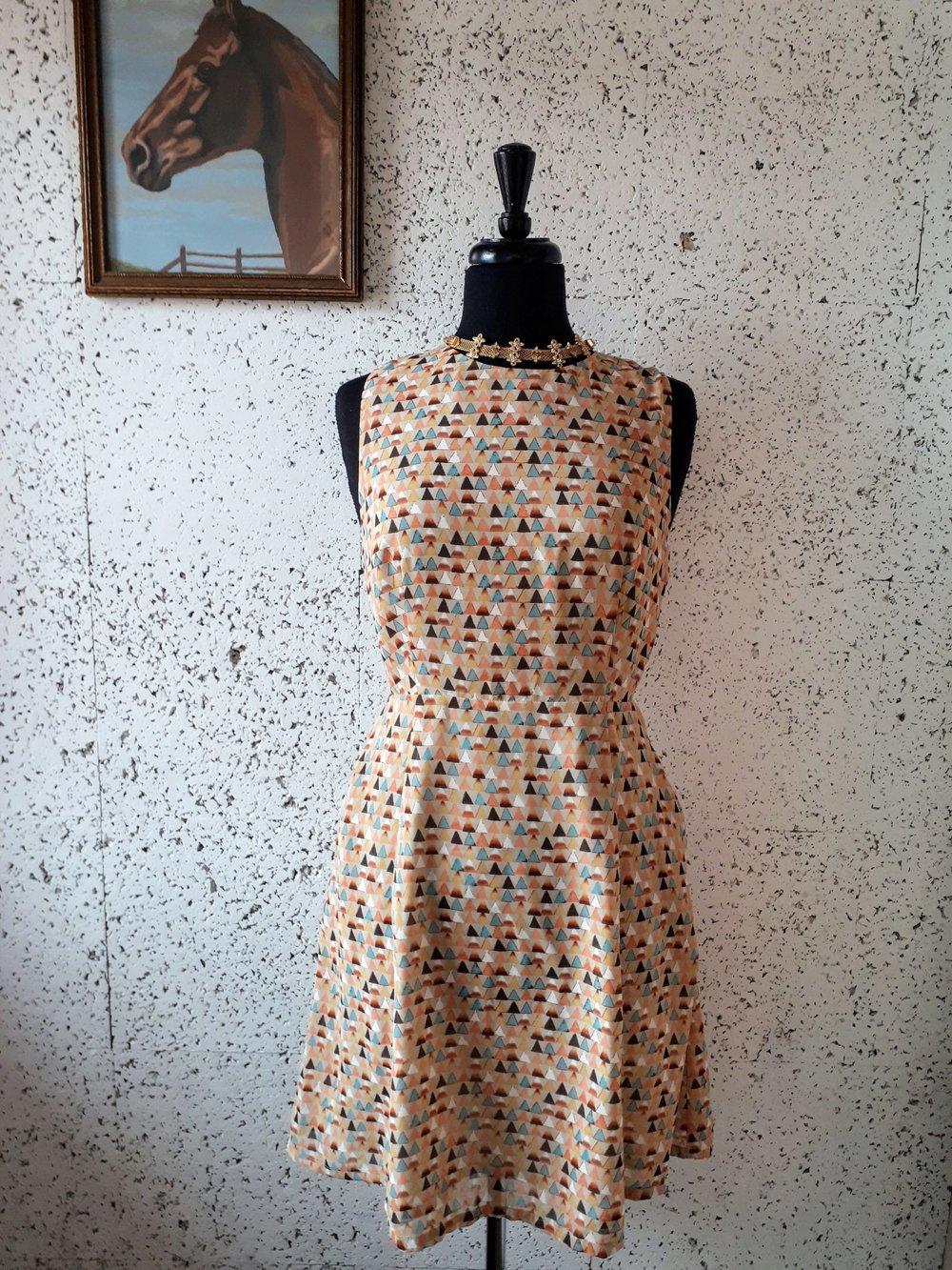 Loft 82 dress; Size S, $38. Necklace, $22.