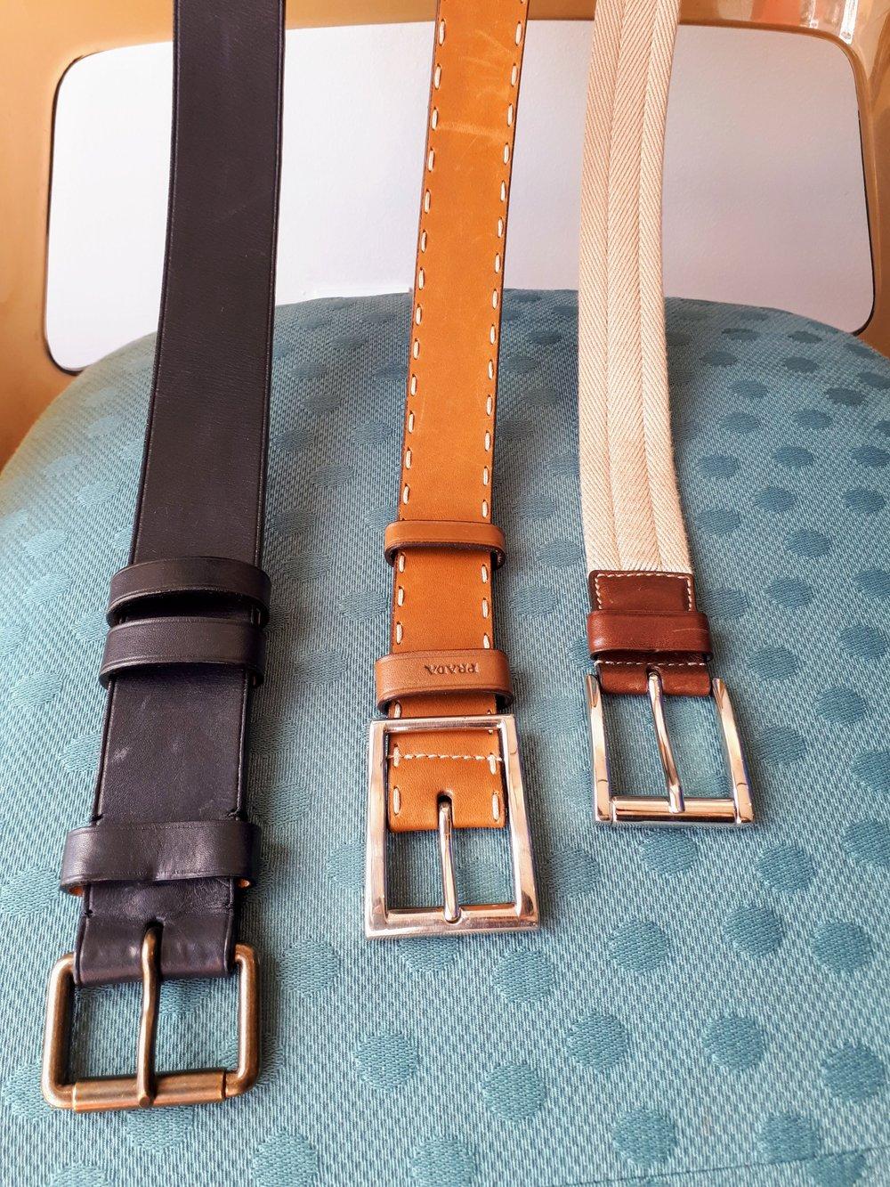 Louis Vuitton belt, $48; Tan Prada belt, $46; Light Prada belt, $40