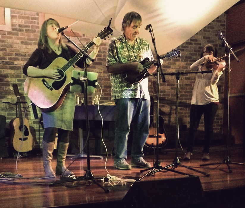 Mandy and Bruce Harvey sharing the stage at the Random Howse on Orcas Island, 2016