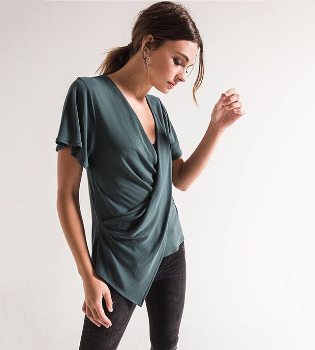 The Sandra Draped Surplice Top is 100% date night approved. #blackswanclothing