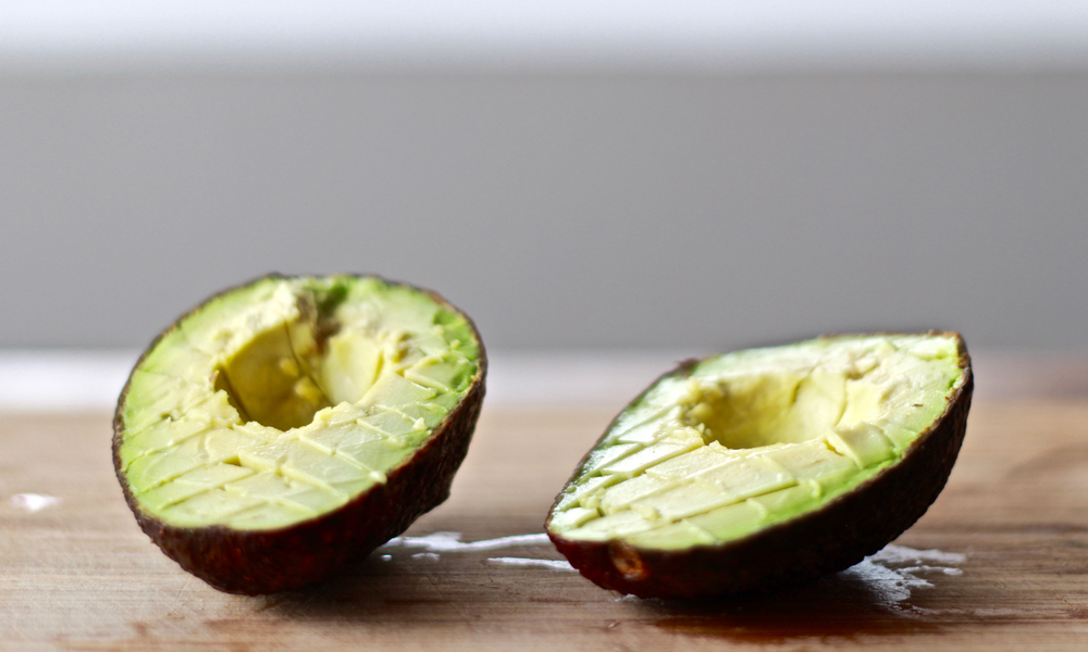 Cut diagonal lines to the right and then diagonal lines to the left to make square/diamond shapes on the avocado (Optional: Scoop the half of avocado and dice).