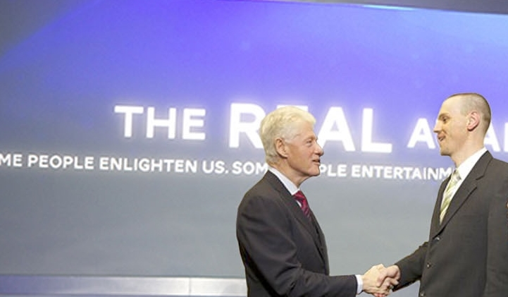 President Clinton presenting  a Real Award to one of our U.S. Health Worker honorees.
